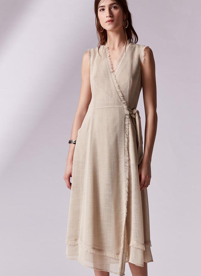 letizia ortiz y el vestido cruzado y con flecos de adolfo dominguez