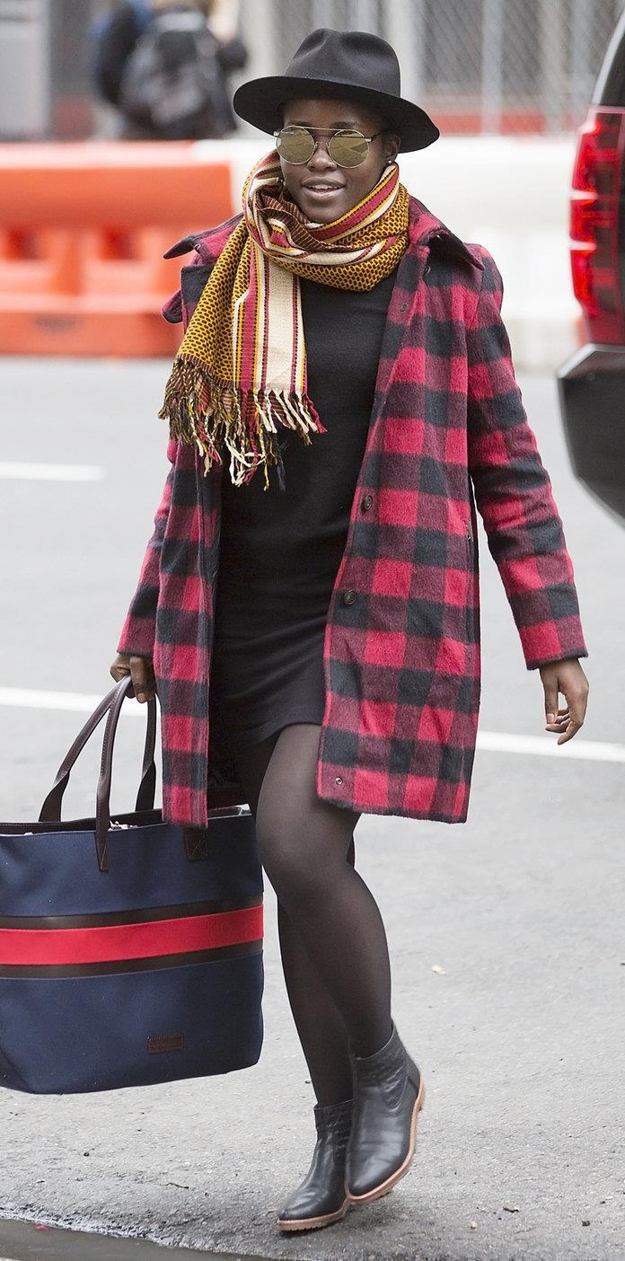 Lupita Nyong'o.  Lupita Nyong'o with black booties