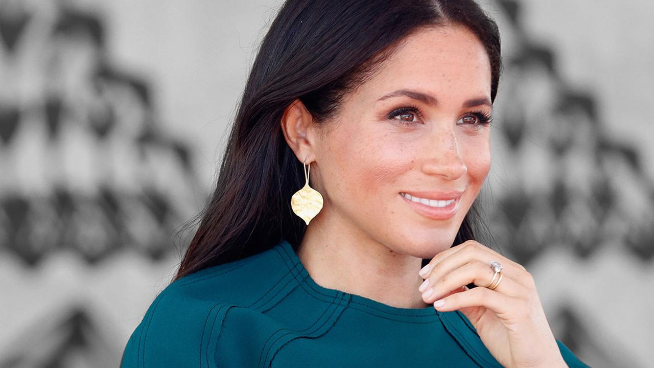 e9b6703ea Meghan Markle repite un look de cuando era novia del príncipe Harry -  InStyle