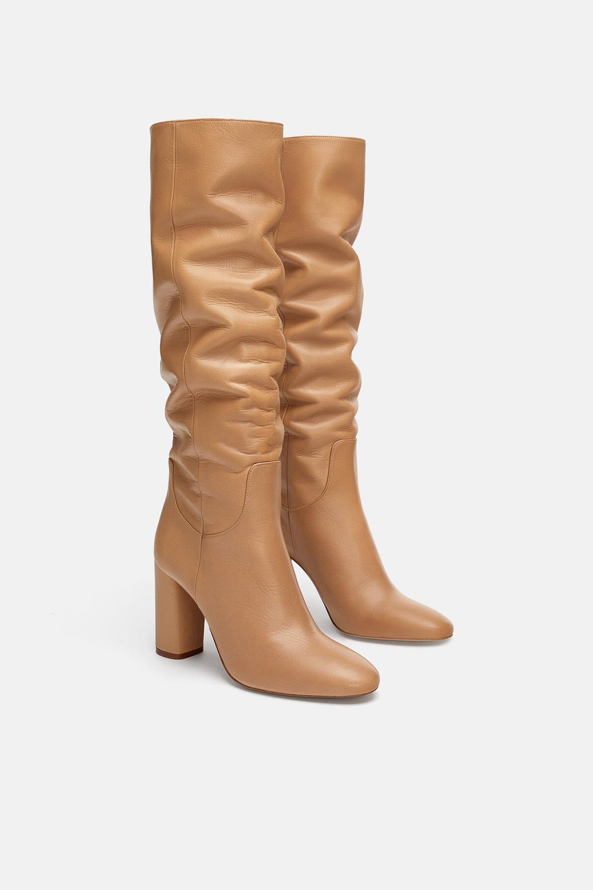 b06d661d8 botas-altas-moda-rebajas-arrugadas-setentas. Las botas altas de