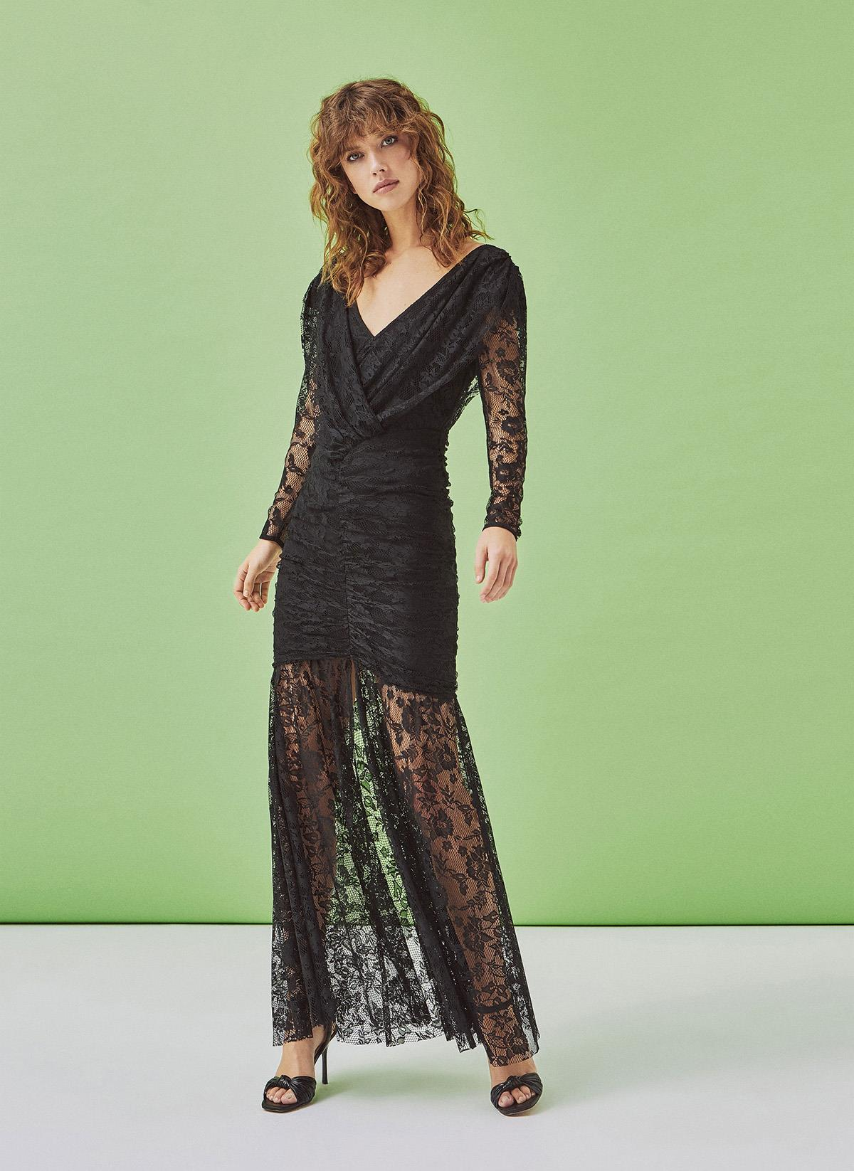 72f57023cd7 1-vestido-encaje-negro-feria-uterque. Vestido de encaje negro