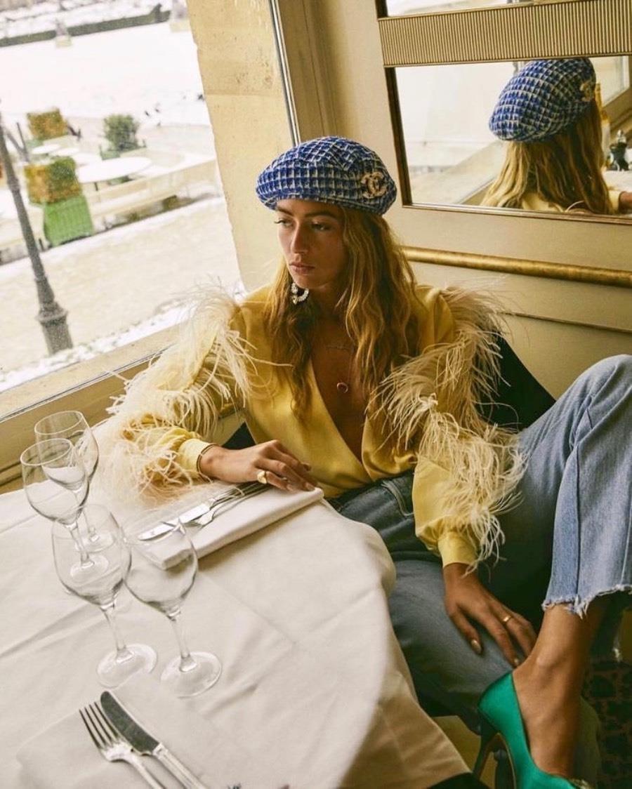 Emili Sindlev with beret in Paris