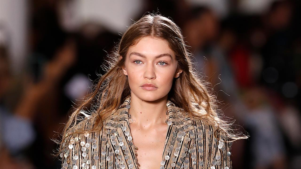 Gigi Hadid has fallen for a lowered Mango coat and some wonderful corduroy knee high boots